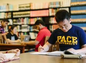 Pace students in the library of pace university pathways