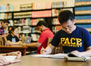 Pace student in the library