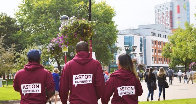 Three people enjoy the student experience at Aston University by wearing Aston sweaters