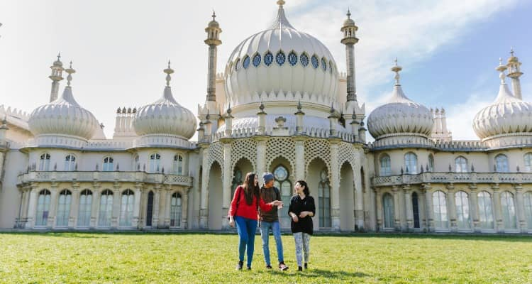 Students in the gardens outside Brighton Pavilion