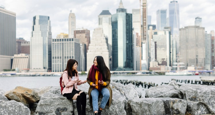 Students chatting by New York's skyline