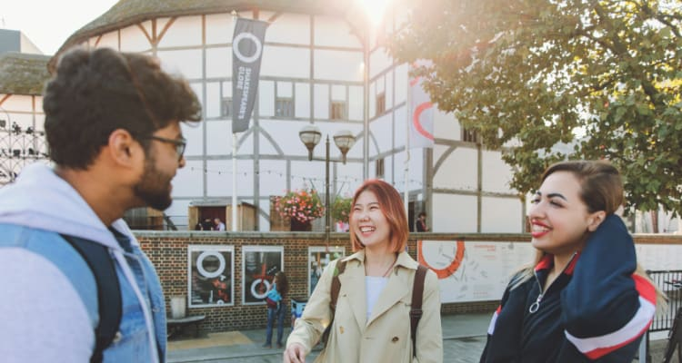 Students having fun in front of the Globe Theatre - budget in london