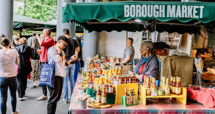 Students walking around Borough Market - budget in london