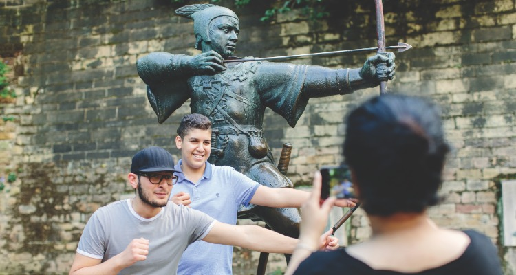 Taking pictures with the statue of Robin Hood - budget nottingham