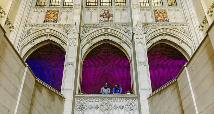 Students talk together inside one of the University of Bristol's historic buildings