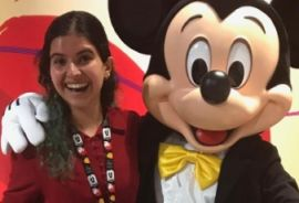 Marah with Mickey Mouse during her internship at Disney
