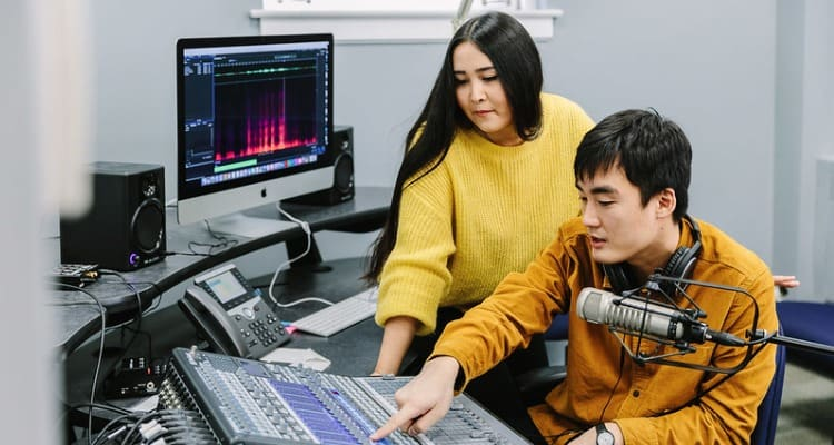 Two students using technology as part of their degree program