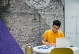 A student studies at Kaplan International College London