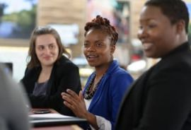 Three women at the Simmons Leadership Conference