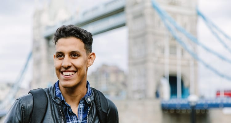 London student in front of Tower Bridge
