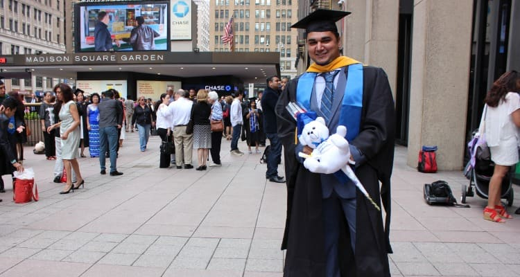 Jecky at his graduation outside Madison Square Gardens in New York City