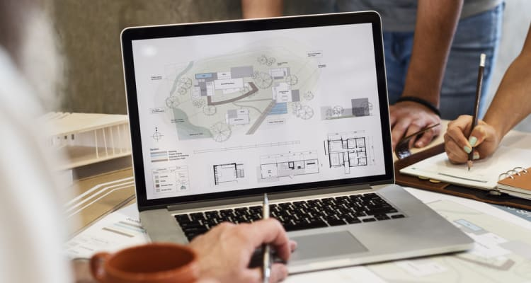 Building design on laptop screen