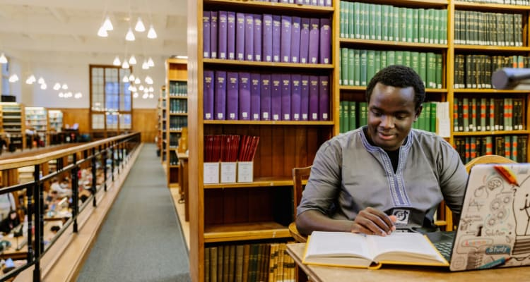 Bristol international student studying in library