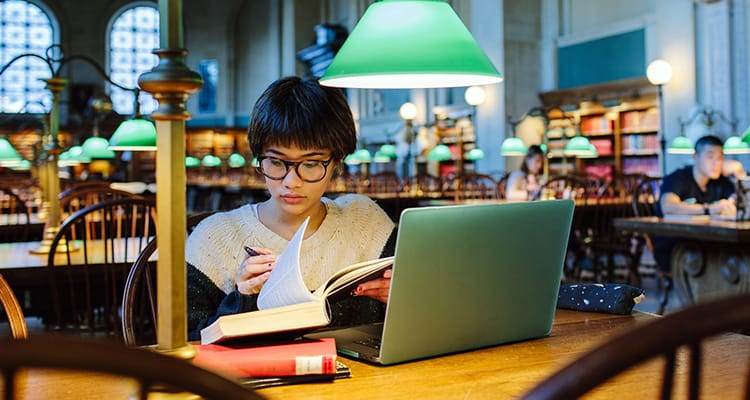 Student girl studying in a library