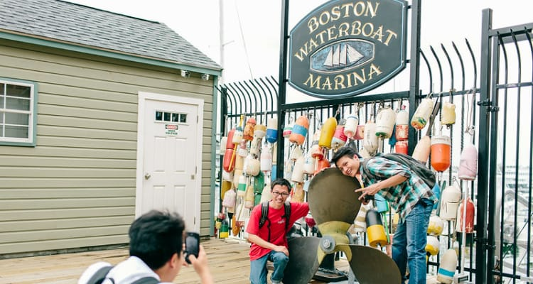 students clicking picture in Boston harbour